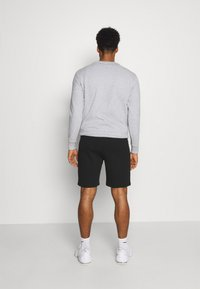 Ellesse - ASTERO SHORT - Sports shorts - black - 2