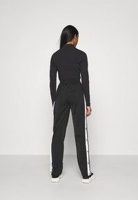 adidas Originals - ADIBREAK - Tracksuit bottoms - black - 2