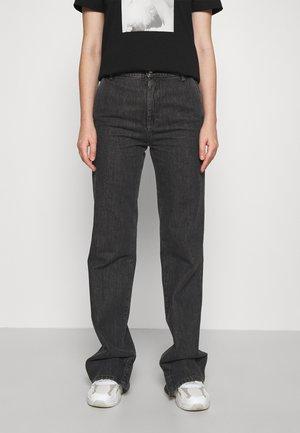 ROLANDA - Jeans a zampa - black