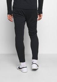 Nike Performance - DRY ACADEMY SUIT - Tracksuit - black/black/white/white - 4