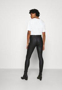 ONLY - ONLCHRISSY SKINNY COAT  - Jeans Skinny Fit - black - 2
