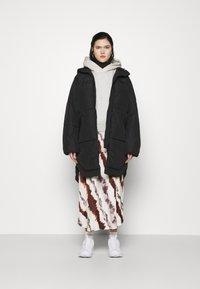 Weekday - RUT PUFFER JACKET - Winter coat - black - 1
