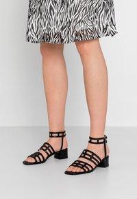 KIOMI - Sandals - black - 0