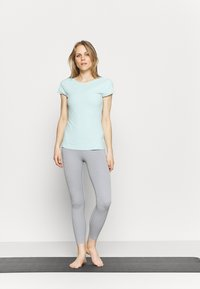 Nike Performance - THE YOGA LUXE - Basic T-shirt - teal tint/barely green - 1
