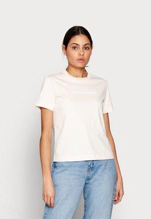 SHRUNKEN INSTITUTIONAL TEE - T-shirt imprimé - beige