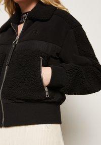 Calvin Klein Jeans - POLAR SHORT JACKET - Winter jacket - black - 5
