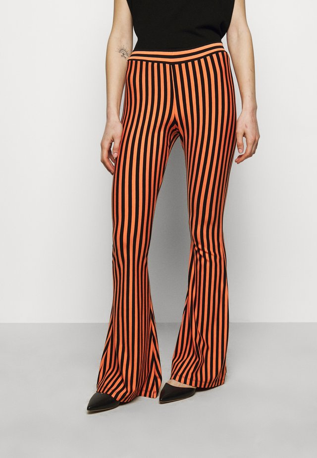 RAJ FLARED LEGGINGS - Leggings - Trousers - nectarine