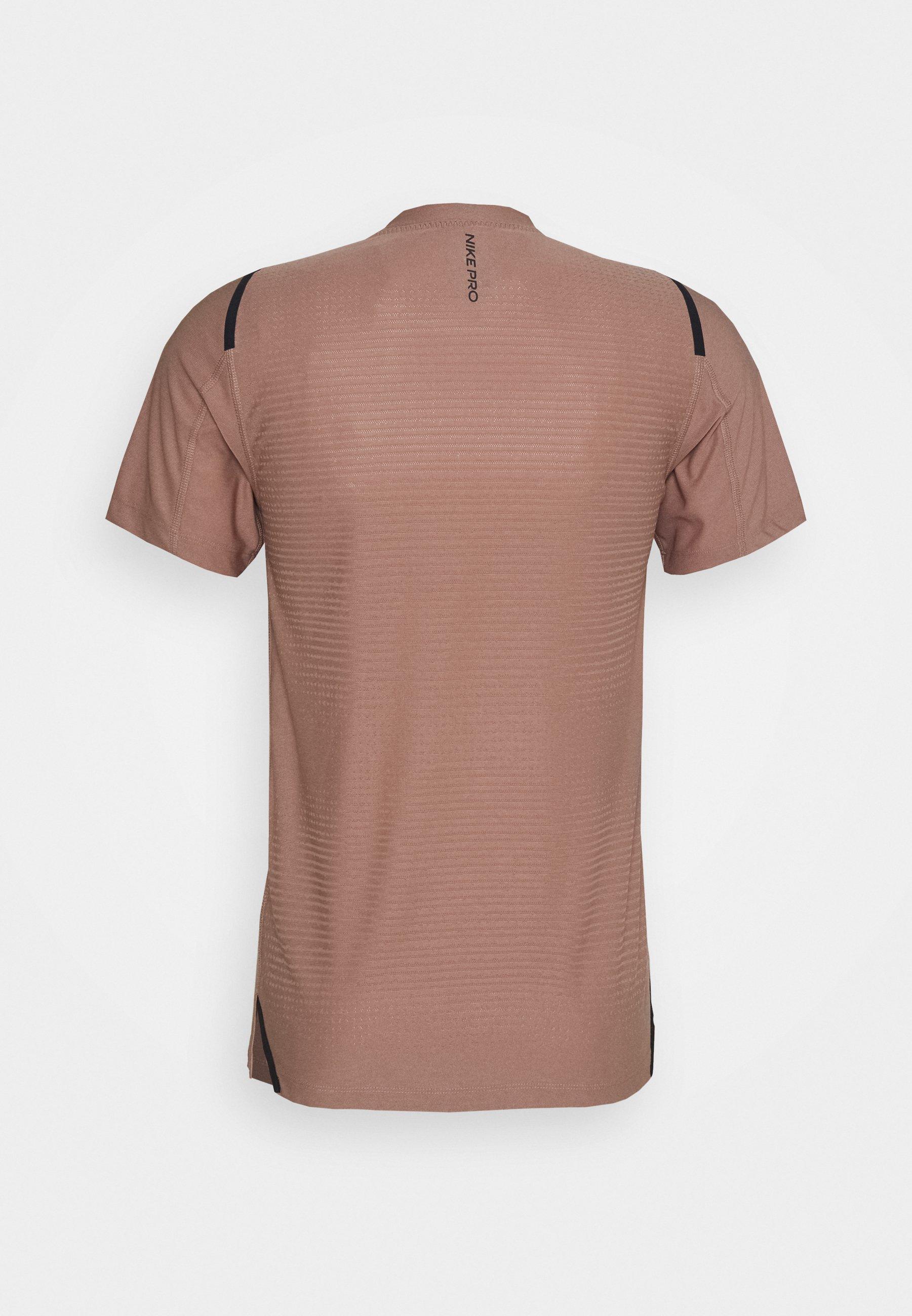 Nike Performance T-shirt de sport - desert dust/black