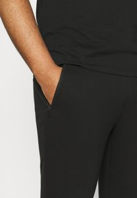 Johnny Bigg - TROY CUFF TRACKPANT - Tracksuit bottoms - black - 4