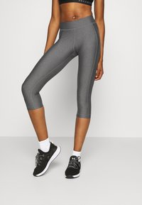 Under Armour - HEATGEAR CAPRI - Pantalon 3/4 de sport - charcoal light heather - 0