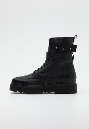THE OTHER SIDE - Platform ankle boots - black