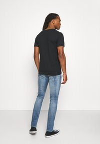 Replay - ANBASS AGED - Slim fit jeans - light blue - 2