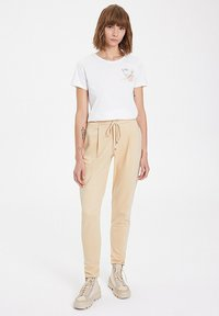 WESTMARK LONDON - Tracksuit bottoms - semolina - 1