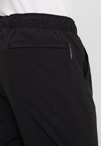 The North Face - TECH PANT - Spodnie treningowe - black/white - 4