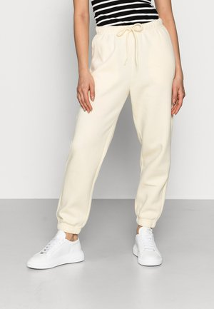 PCCHILLI PANTS - Tracksuit bottoms - almond oil