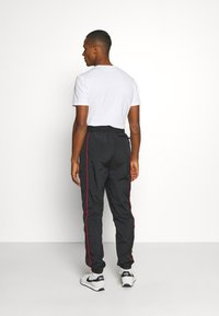 Jordan - FLIGHT WARMUP PANT - Trainingsbroek - black/university red - 2