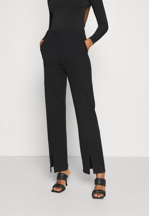 KLARA TROUSERS - Trousers - black