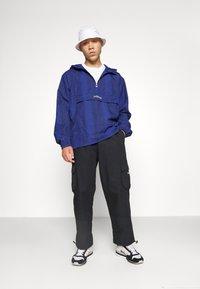 adidas Originals - WINDBREAKER - Giacca leggera - victory blue/black - 4