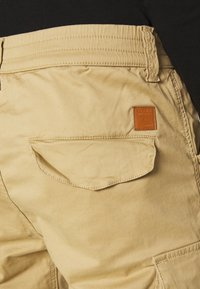 Alpha Industries - AIRMAN - Cargo trousers - sand - 5