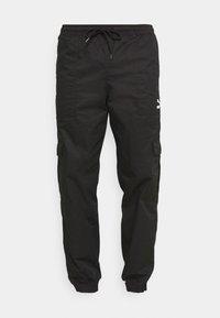 Puma - CLASSICS   - Cargo trousers - black - 3