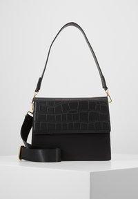 Pieces - CHRIS CROSS BODY - Handbag - black/gold - 0