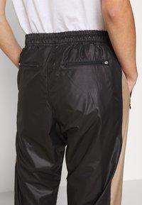 H2O Fagerholt - ALWAYS TRACK PANTS - Tracksuit bottoms - black - 5