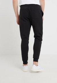 Polo Ralph Lauren - Pantalon de survêtement - black/gold - 2