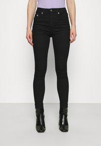 Calvin Klein Jeans - HIGH RISE ANKLE - Skinny džíny - denim black - 0