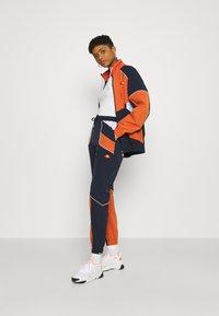 Ellesse - RACE TRACK PANT - Pantalones deportivos - green - 1