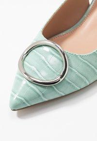 Dorothy Perkins - EMMA CROC SLING POINT - Classic heels - green - 2
