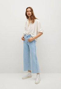 Mango - CAROL - Flared Jeans - light blue - 1