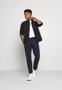 Tommy Jeans - SCANTON DOBBY TRACK PANT - Trousers - twilight navy - 1