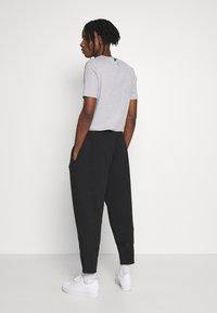 adidas Originals - WARMUP - Tracksuit bottoms - black - 2