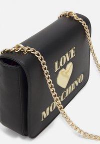 Love Moschino - Across body bag - nero - 4