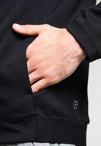 Puma - BONDED TECH  - Fleece jacket - black - 4