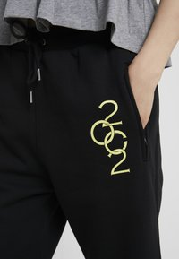 Opening Ceremony - Tracksuit bottoms - black - 3