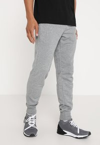 Puma - ESS LOGO PANTS - Tracksuit bottoms - medium gray heather - 0