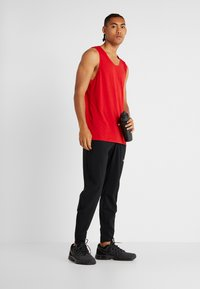 Nike Performance - TANK DRY - Sports shirt - university red/black - 1