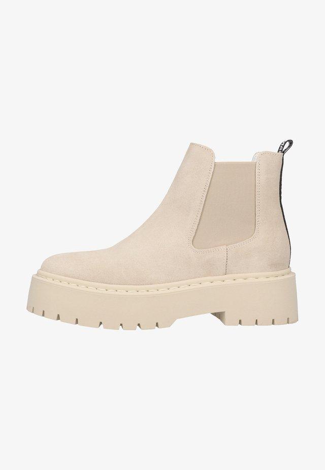 Korte laarzen - beige suede