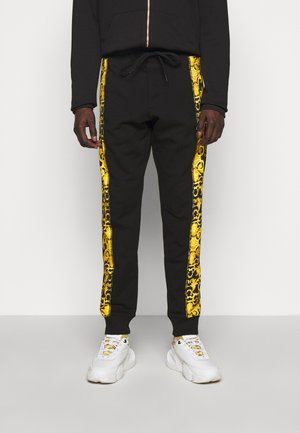 PRINT LOGO BAROQUE - Tracksuit bottoms - black