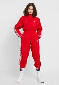 adidas Originals - ADICOLOR SPORT INSPIRED NYLON JACKET - Windjack - scarlet - 1