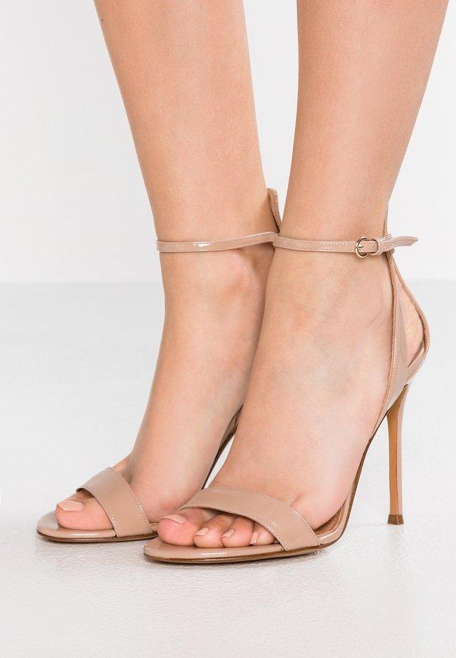 High heeled sandals - face