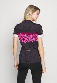 Ziener - NELSA - T-Shirt print - black/pink - 2