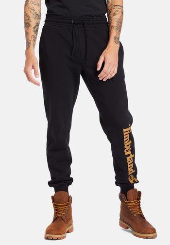 CORE TREE  - Pantaloni sportivi - black/wheat boot