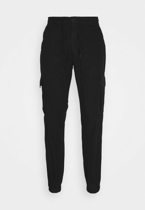 DPSURVIVE - Cargo trousers - black