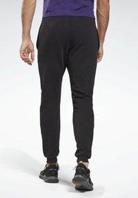 Reebok - SMALL LOGO ELEMENTS JOGGER PANTS - Tracksuit bottoms - black - 2