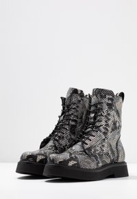 MJUS - Kotníkové boty na platformě - nero - 4