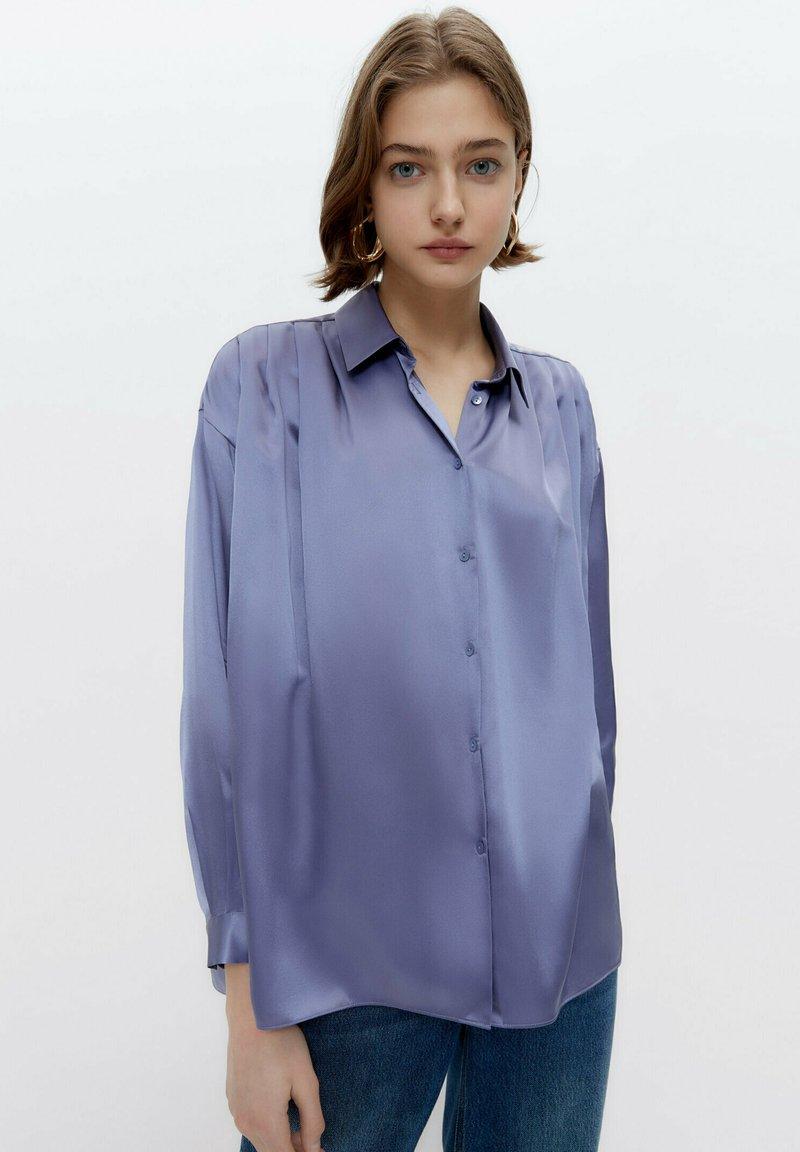 Uterqüe - Button-down blouse - light blue
