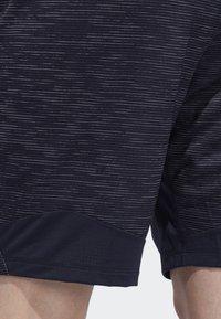 adidas Performance - 4KRFT SPORT STRIPED HEATHER SHORTS - Sports shorts - blue - 6