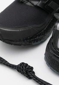 adidas Performance - ULTRABOOST PRIMEKNIT RUNNING SHOES - Neutral running shoes - core black/iron metallic - 5